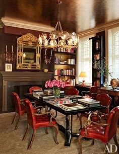 A dining room decorated in rich color | archdigest.com