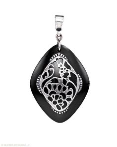 STERLING SILVER & BLACK GLASS PENDANT  RETIRING ITEM    $69    Discover the tricks of chic style with this Sterling Silver and Black Glass Pendant. (Necklace sold separately.)