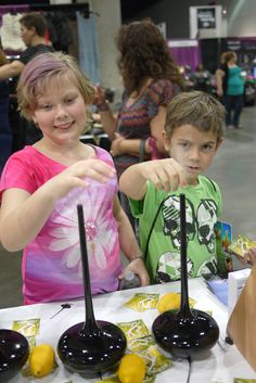 Brother and sister playing with our Ultrasonic Broom Diffusers at the Ultimate Women's Expo in Los Angeles.