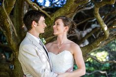 Bride and groom portrait beneath twisted tree branches | Tyler Arboretum Wedding by Ashley Gerrity Photography