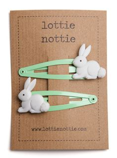 New for 2015 these new hair clips are perfect for bunny lovers and make a great alternative to chocolate for Easter. Sweet little bunny rabbits with fluffy white tails on a lovely light greensnap hair clip. 5cm x 2cm Not suitable for children under 36 months due to small parts – Choking Hazard.