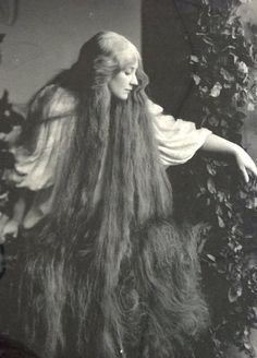 """Mary Garden as Mélisande sings """"Mes longs cheveux"""" while she hangs her long hair out a tower window in """"Pelléas et Mélisande"""" the opera by Claude Debussy, based on the play by Maurice Maeterlinck, 1902"""