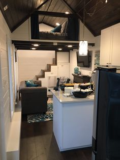 This is Trinity, a tiny house by Alabama Tiny Homes. She is 28 feet long, 13'4′ tall and 8'5″ wide and features the very popular white-on-dark wood color scheme we keep seei…