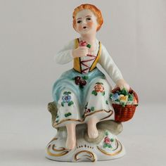 Vintage Sitzendorf Germany Porcelain Figurine of Seated Girl with Flowers by Antik Avenue from The Vintage Village