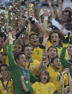 Brazil's Thiago Silva, center, lifts the trophy after winning the soccer Confederations Cup final between Brazil and Spain