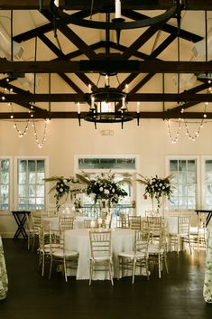 Draped throughout the wood beams, our warm Cafe Lights gorgeously lit up this wedding reception at Alhambra Hall, SC to create an ambiance that was both intimate and classy. Check out our website for more lighting inspiration! #Charleston #WeddingIdeas #Lights #RomanticWeddingDecor #Floral #Reception Romantic Wedding Decor, Rustic Wedding Reception, Rustic Weddings, Alhambra Hall, Indoor Wedding Receptions, Event Services, Scenic Design, Wood Beams, Twinkle Lights