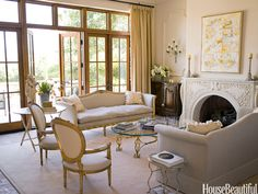 Classic style w some trendy punch; love the gilded tables/skinny legs