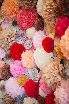 If you're feeling really ambitious, create a pom-pom wall of different colors and sizes for a wedding backdrop à la Kim Kardashian.  Photo by Love Is A Big Deal via Style Me Pretty