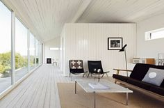 """Summer house in Gotland...  I was browsing through Sköna Hems website and it wasn't long (as always) until I came across some inspiration.  Here is a beautifully styled house in Gotland, Sweden - very much my taste - pale floors, lots of white, black, simple lines with a backdrop of water.  They even have the Pia Wallen 'Crux' blanket that I have on had my wish list for ages..."""