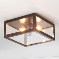 Modern Industrial Ceiling LightSimple, modern, and classic with a hint of industrial style describes this versatile Chrome or darkened Bronze metal frame with glass panels ceiling light.