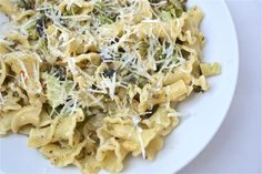 Broccoli Olive Pasta: 1/2 pound pasta, such as penne Fine sea salt 2 Tablespoons extra virgin olive oil 2 cloves garlic, minced 3 Tablespoons pine nuts 1/2 cup black olives, pitted and chopped 1 pound broccoli, chopped (peel and chop stem, too, if you like) Freshly ground black pepper Freshly shredded Parmesan or Asiago