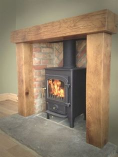 Most current Pics Brick Fireplace surround Suggestions Clearvier pioneer 400 chunky oak surroun reclaimed yorkshire stone hearth herringbone brickwork. Wood, House Design, Home Living Room, Fireplace Surrounds, New Homes, Log Burner Living Room, Home Decor, Fireplace, Wood Burning Fireplace