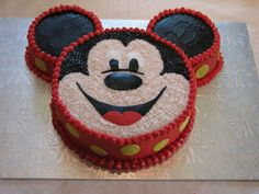 Mickey Mouse Cake Thanks to CareyI for the idea/inspiration.Buttercream icing with fondant yellow polka dots, and facial features.Cake is...