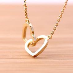 crossed OPEN HEART necklace.