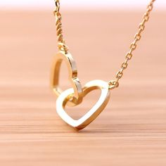 crossed OPEN HEART necklace.