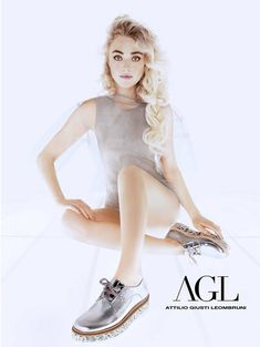 Marking her fifth season as the face of AGL (Attilio Giusti Leombruni) shoes, actress Dakota Fanning shows off her soft side for the label's spring-summer 2016 campaign. Wearing her hair in Rapunzel style waves, the blonde poses for Tom Munro in a dreamy pair of portraits. In one image, she can be seen wearing a …