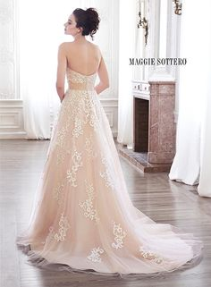Lace and tulle A-line wedding dress with subtle soft scoop neckline and detachable grosgrain ribbon belt with Swarovski crystal brooch, Ellarae by Maggie Sottero.