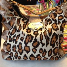 Arzon Brazilian Leopard Print Genuine Leather This a perfect for winter has a few fadings shown in pic and lipstick marks in back zipper compartment will show pics if requested has inside middle zipper compartment and very roomy I would always get lots of compliments when carried this gorgeous bag I kno you'll love shoot me an offer Bags Shoulder Bags