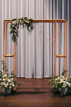 Industrial copper wedding ceremony arbour with florals in concrete pots | Duuet Photography