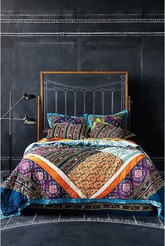 chalkboard wall backdrop for colorful textile bedding boho style