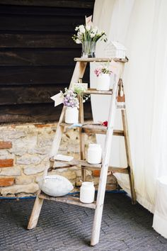vintage rustic painting stairs transformed into shabby chic decoration for a summer wedding | Image by Liam Smith Photography
