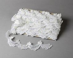 This lace is hand beaded with pearls and sequins. Description from ebay.com. I searched for this on bing.com/images