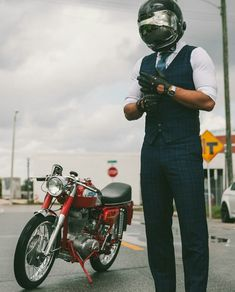 The suited racer . Motorcycle,  sweet tailoring and Biltwell helmet.