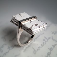 Love Letter Ring, great as an engagement ring. This is very unique. I think this is super - really unusual and personal. Source: http://www.76hudson.com 20121231 16:09