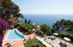 Punta Tragara       Where: Capri, Italy  Occupying a postcard-perfect location on the isle of Capri, Punta Tragara has a breathtaking location over the famed Faraglioni rocks. Accordingly, the views from the two pools and all outdoor areas are incredible. 25 amazing hotels with eye-popping views