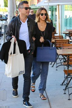 Jessica Alba wearing Persol Po3105 Sunglasses, Sol Sana Metallic Evie Leather Sandals, Avgvs Byblis Mid Tote in Delft Blue and Luna Skye Gold and Diamond Single Band Moonstone Ring