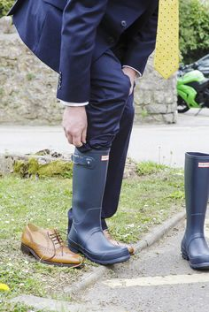 Close up shot of grooms feet and wellies