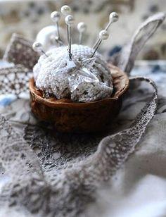 We used to make walnut shell pincushions with Akaroa walnut shells.