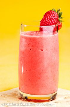 A fresh strawberry smoothie isolated over yellow