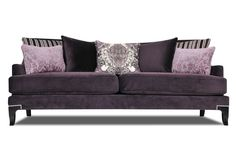 Charleston Sofa on living spaces...gorgeous couch. Silver studs at base.