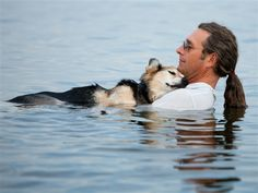 The owner takes his dog( who has arthritis) out in the water to alleviate his pain. The alleviation of the pain helps his dog relax and sleep while in the water. It is a sweet story.  Hannah Stonehouse Hudson / Stonehouse Photography