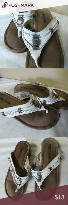 Minnetonka leather 7/8 flip flops Used condition. Label size 7 personally I find it fits a 7/8 just fine cushion bottom for all day comfort braided leather design with bead accents. Please check out my other items save 25% off automatically when you bundle three or more offers are welcome and encouraged. Please take a moment to pray for our troops overseas that they may return home safely to their families Minnetonka Shoes Sandals