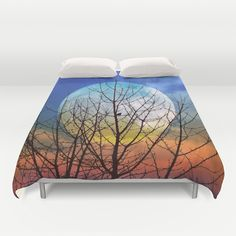 The moonwatcher Duvet Cover by Pirmin Nohr - $99.00 A little bird sitting in a naked tree watching the fullmoon  sky, clouds,fullmoon, bird,tree,orange,blue