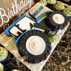 Third birthday blue tractor farm cake for toddler boy, hand-carved and covered in ganache and fondant.  By The Cake Mom  Co.