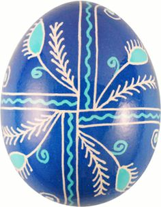 Pysanka with Wheat motif which symbolizes a bountiful harvest, and with Pine Needle motif which symbolizes growth and eternal life. Blue represents good health and truth, and white represents purity, light, and rejoicing