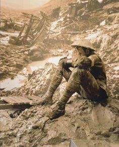 WWI. Australian soldier sitting in the Mud with his head in his hand on the Western front.