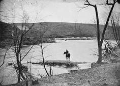 The view here is southwest and note the upstream pontoon bridge, with several Union soldiers lounging, thereupon. Note the mill dam and mill pool, with Tom Stubblefield's grist mill on the left. The officer on horseback probably belongs to the 50th New York Engineers, as that worthy outfit's camp was situated just to the north of this spot.