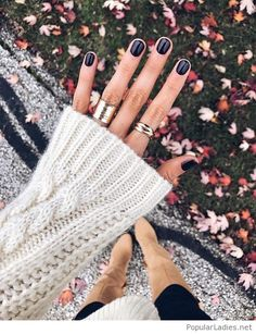 Black nails with gold rings