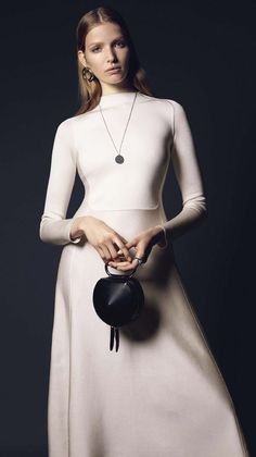 Dress, Hermès. Earring, J.W. Anderson. Necklace and ring, Tom Wood. Bag, 3.1 Phillip Lim.