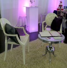 10' x 10' booth - LED pedestal table, Ghost arm chairs, Ellora side table, and accent pillows.