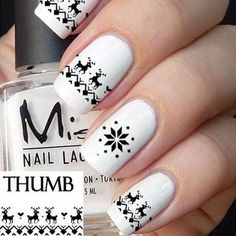white-reindeer-print-pattern-nails