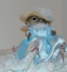 Sugar Bush has had a wonderful May Day today in a gorgeous Tiffany Blue Gown by her favorite designer, Valentinut. Sugar Bush also had her nails done in Tiffany Blue to match her fashionable hat and gown.