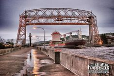 'Sailing Through The Duluth Aerial Lift Bridge' by Shutter Happens Photography | Follow us on Facebook and Twitter, and see our entire catalog at ShutterHappens.com