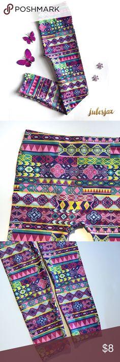 Girls 12-14 tribal bright print leggings NWOT, super cute leggings in pink, purple, blue, yellow, & green tribal like geometric print.  Girls sz 12-14 Bottoms Leggings
