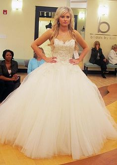 AAAAAHHHH! She's @ Bridals by Lori!!!!! I LOVE THAT PLACE!!!!!!! I watch Say Yes to the Dress allllllll the time!!!!! And that's a pretty dress.