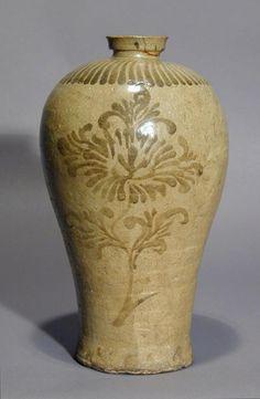 Korean stoneware maebyong, circa 1200, unglazed, iron oxide peony floral design